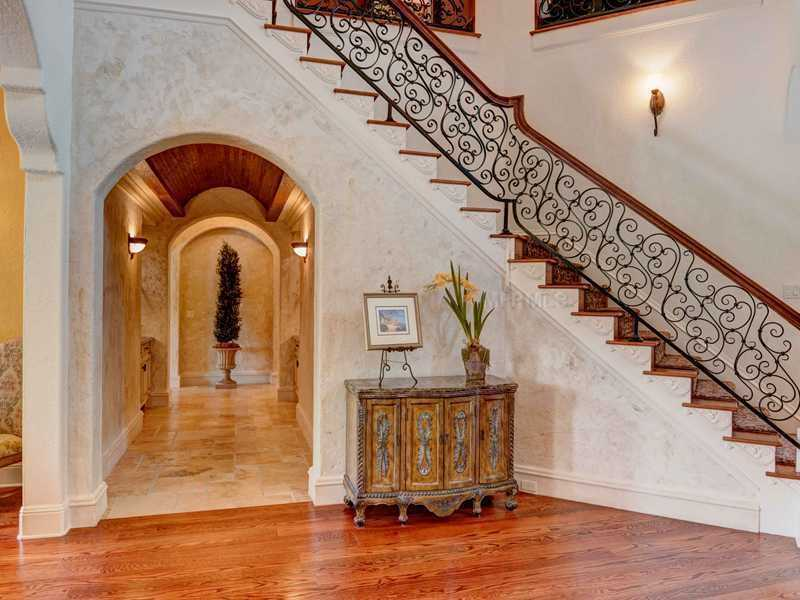 Limestone accents and flooring along the staircase.