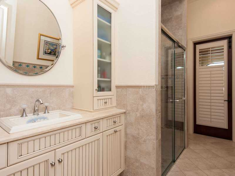 En suite full bathroom with tiled shower.