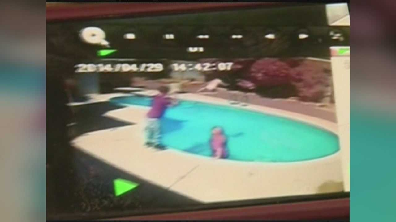 An Arizona father is facing charges after being accused of throwing his own 1-year-old into a pool, and the whole incident was caught on surveillance video.