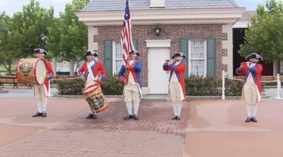 Throughout the day in front of The American Adventure attraction at Epcot, guests can catch the Spirit of America Fife & Drum Corps.
