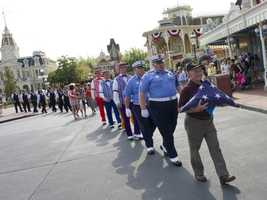 Everyday at 5 p.m. in the square at the entrance to Main Street, USA at the Magic Kingdom, the flag retreat ceremony is held. The flag is lowered, folded and a special guest is selected to participate.