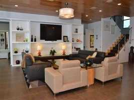 The family room also features recessed lighting.