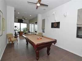 This loft space behind the gym is the perfect space for a pool table.