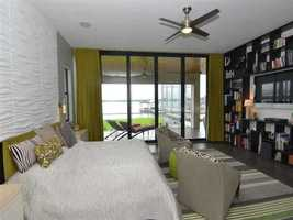 The master bedroom also includes a custom built-in shelving/entertainment unit.