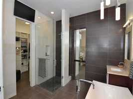 En suite master bathroom features an ultra-sleek design.