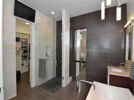En suite master bathroom features an ultra-sleek design.