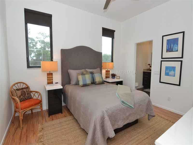 This bedroom is one of three guest suites in the home.