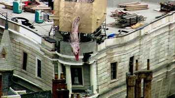 See aerial view of the dragon this sits atop Gringotts Bank in Diagon Alley. The dragon was installed between May 23-25.