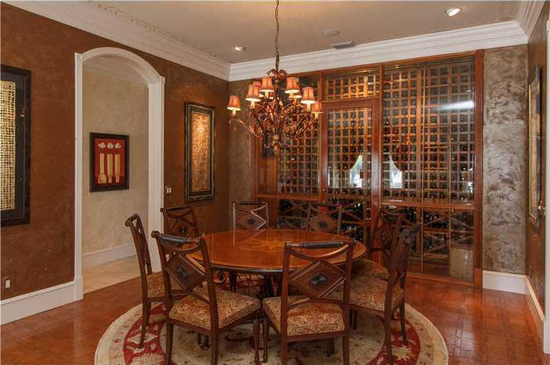 The formal dining room boasts a 12 ft walk-in wine room accommodating over 1,000 bottles of wine.