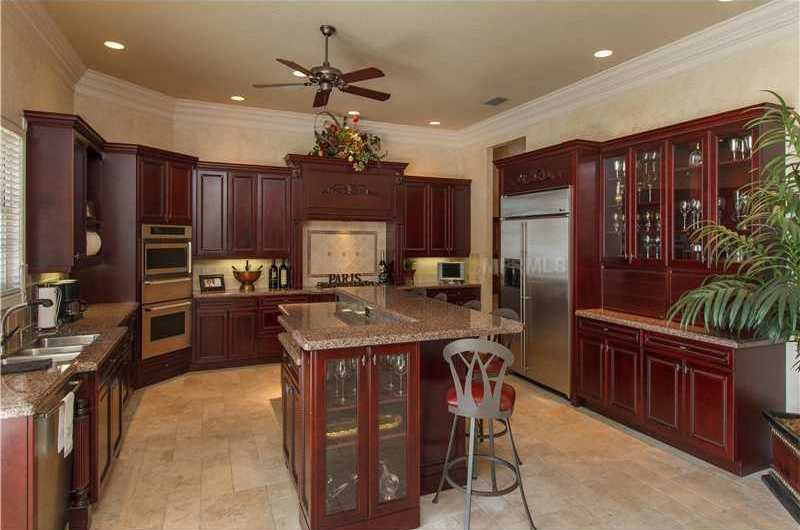 Spacious gourmet kitchen with detailed rose wood cabinets & granite.