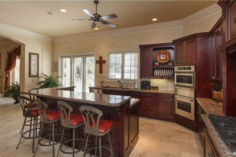 The kitchen looks over the open family space.