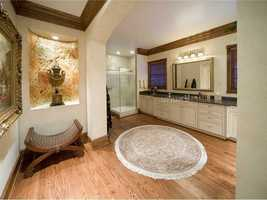 The en suite master bathroom is extremely spacious.