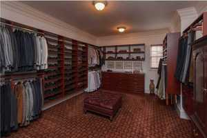 The master closet boasts a custom shelving unit.