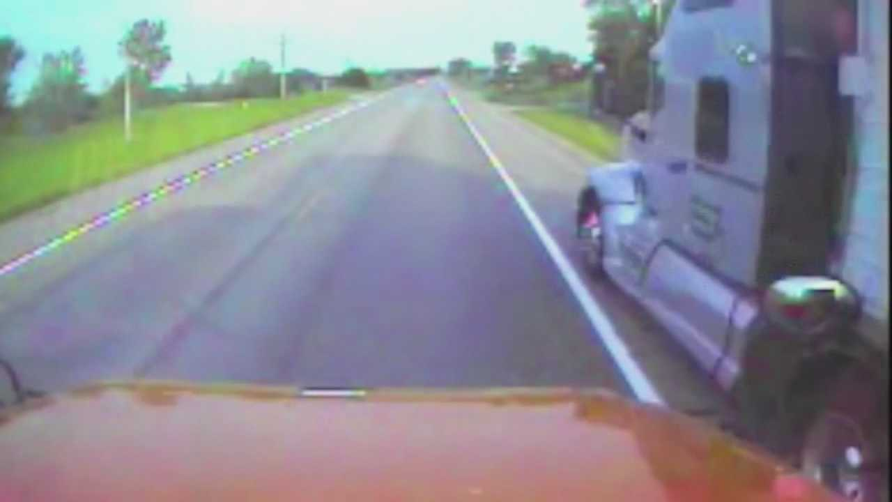 A tractor-trailer is caught on bus video as it speeds passed the stopped school bus. The school bus, that had its flashing lights on and safety arm out, was allowing a student to get off at a stop.