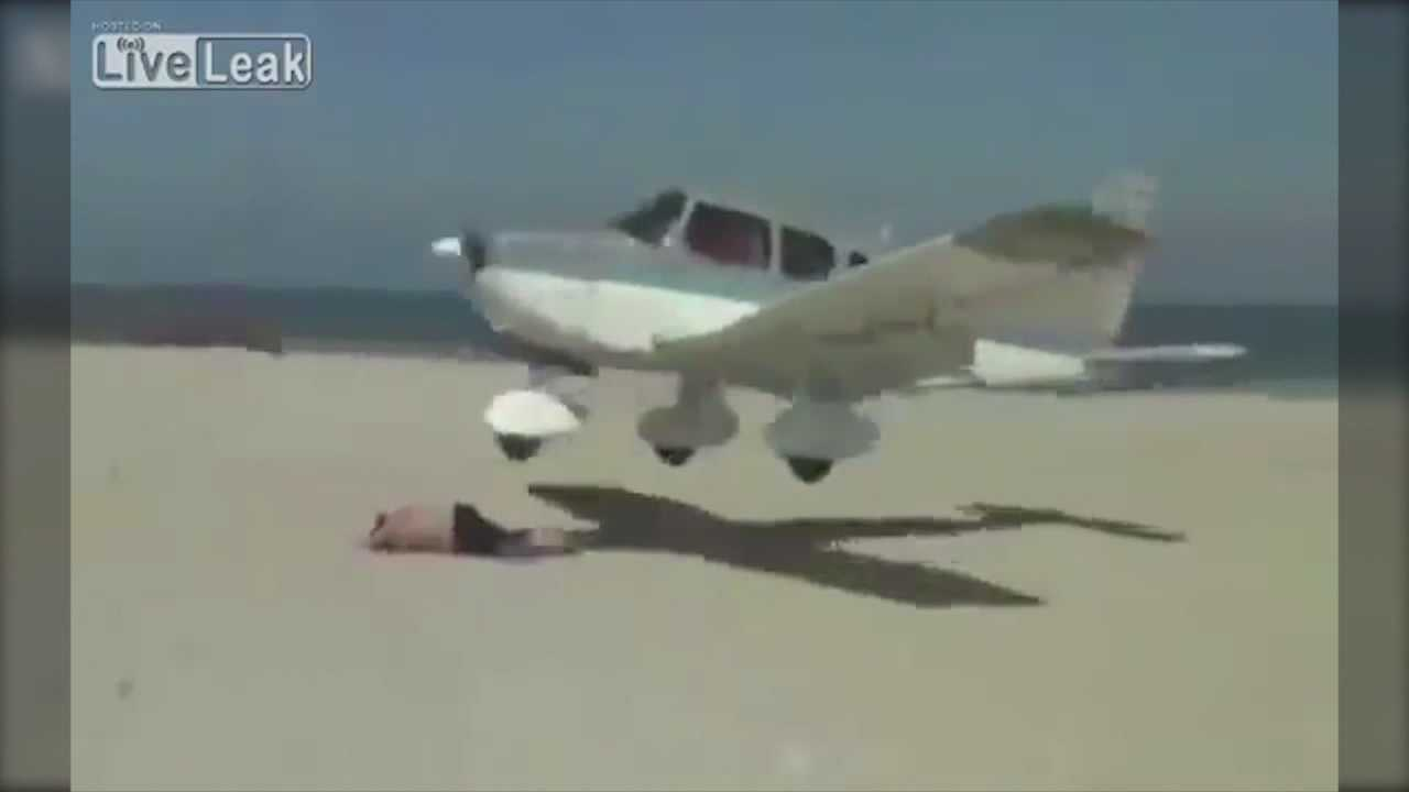 A plane came within inches of taking out a sunbather on a beach in Germany.