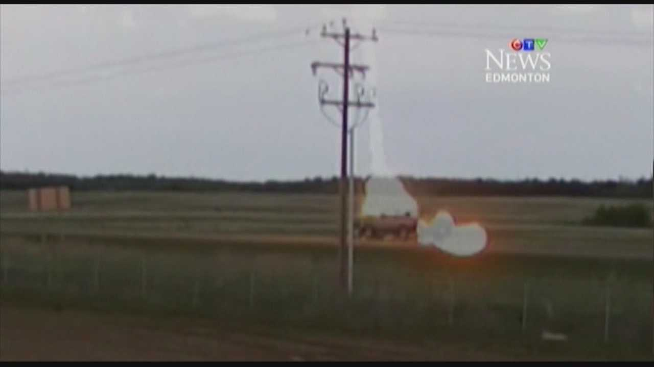A truck driving down a highway in Alberta, Canada was struck by lightning. The whole incident was caught on camera.