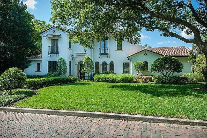 Along a beautiful brick street, this 4,000 sq. ft. property catches your eye and will hold your attention with amazing detailed ceilings, gourmet kitchen and fabulous cabana.