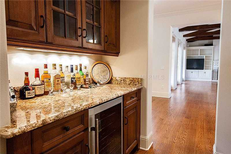 Butler's pantry includes a wine chiller.