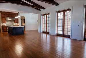 Huge gathering room with high beamed ceilings open to large island chef's kitchen.