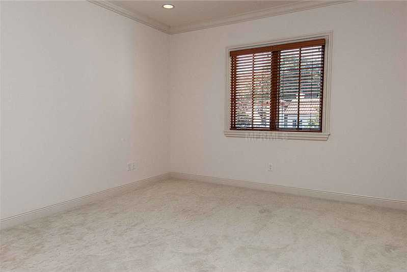 The bedrooms also include large windows and recessed lighting.