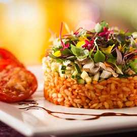 Cinderella's Royal Table offers a fish of the day, as well as the vegetarian option of rice with roasted eggplants, mushrooms, onions and squash tossed with arugula pesto and aged balsamic vinegar.