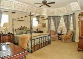 The master suite features a Mediterranean decor.