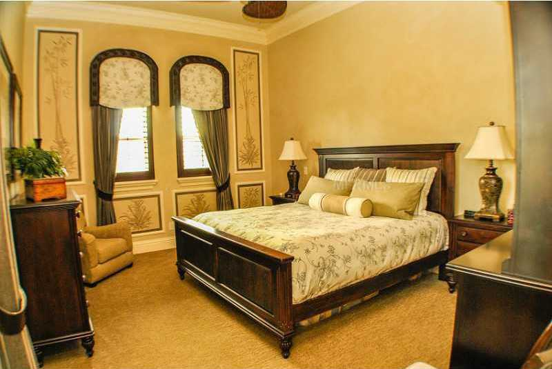This bedroom features Mediterranean accents as well.