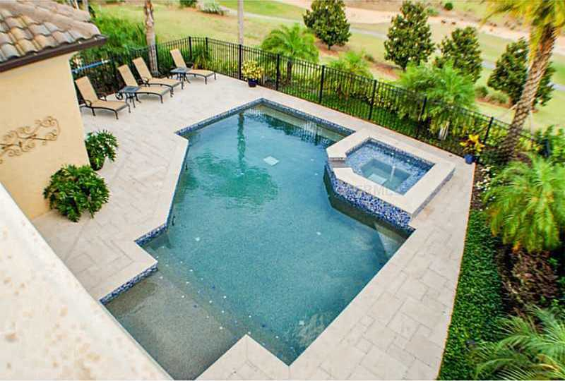 Large pool area also includes a jacuzzi.