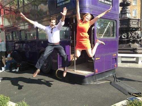 Jason Guy and Stephanie Abrams from The Weather Channel have fun aboard the Knight Bus.