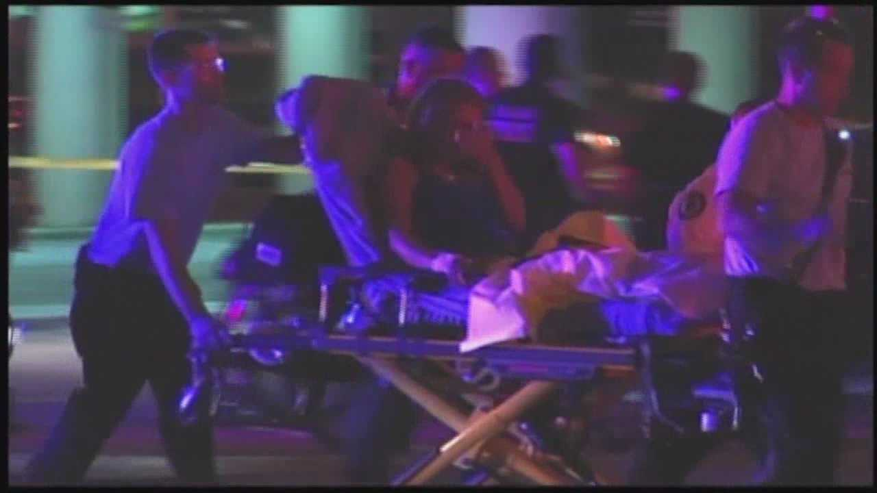 One of the two people were shot Tuesday night at about 2:30 a.m. in Downtown Orlando at parking lot under I-4 said she was sitting on her car with friends when the shots erupted.