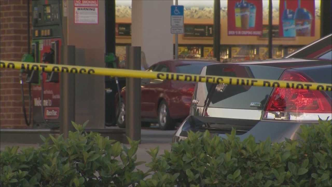 A man was shot and killed outside a RaceTrac gas station Thursday afternoon and the gunman is at large, according to the Orange County Sheriff's Office.