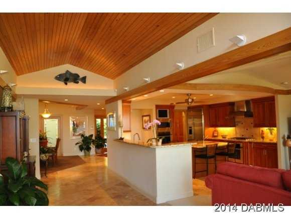 Various rooms have wood paneled ceilings.