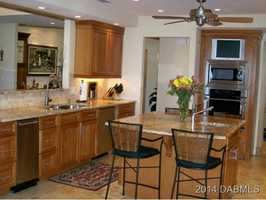 The kitchen has granite counters, cherry cabinetry, a television and various additional perks.