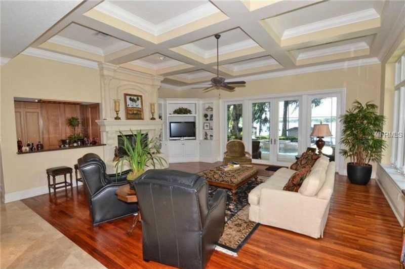 Cozy family room has a fireplace and walk-in wet bar.