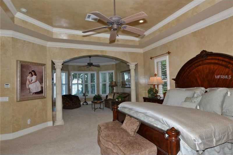 Downstairs master suite with sitting room and fireplace.