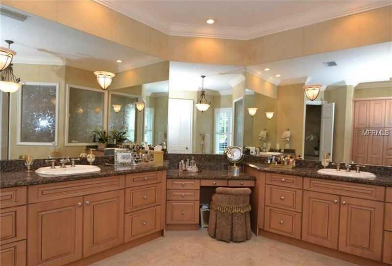 Sprawling master bathroom with dual vanities.