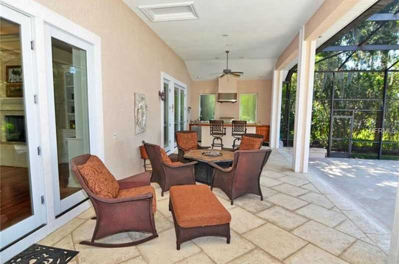 Enjoy stunning sunsets year-round from the large covered lanai with screened solar and gas heated pool , fountain, spa and summer kitchen.