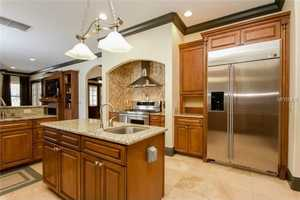 The gourmet kitchen features a dual fuel 5 burner gas range, stainless steel appliances and granite counter tops.