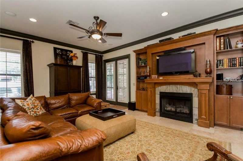 The family room also includes a fireplace and custom entertainment unit.