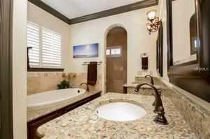 A luxury bath with spa tub in the master bathroom.
