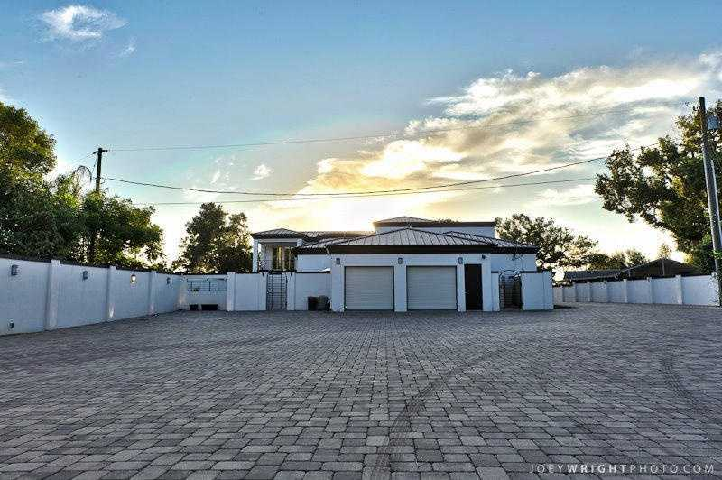 Private driveway leads to the home and luxury garages.