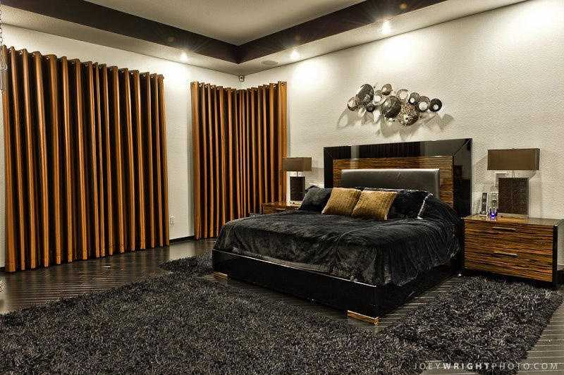 The master bedroom is both sleek and luxurious featuring beautiful hardwood floors.