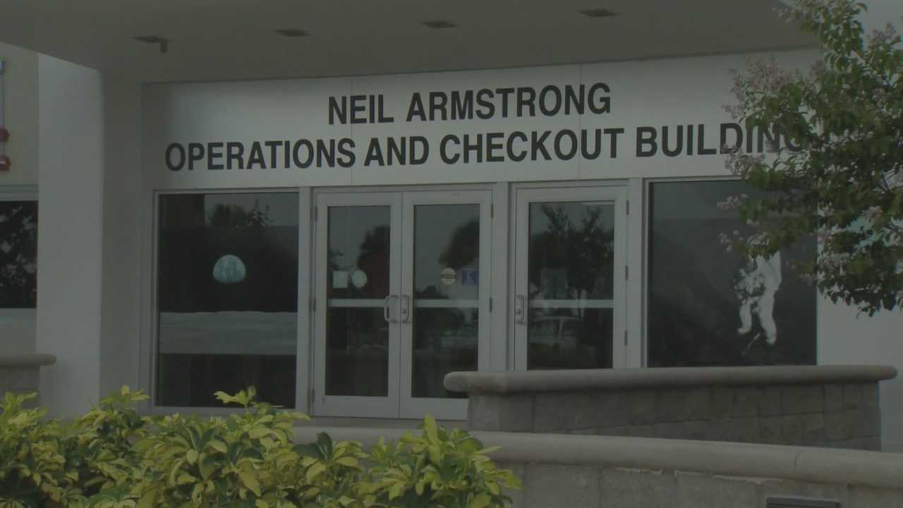 Hundreds of people crowded into the Kennedy Space Center's old Operations and Checkout Building Monday to celebrate its renaming for the late Neil Armstrong.