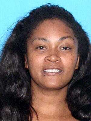 """Alicia Lynette GriffinMissing: 2/1/2014Age then: 37Griffin was last seen in the area of Orlando, Florida. Has medium shoulder length black hair, freckles on her cheeks and a piercing on her right bottom lip. She was last seen wearing a a blue short sleeve shirt with """"Hollister"""" written in green letters, blue jeans and dark colored Nike shoes."""