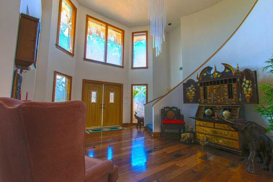 Expect to be impressed as you enter the large wooden doors and enter the beautiful foyer, where you will find glistening wood flooring.