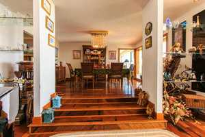 Open floor plan expands from the kitchen to the spectacular dining room.
