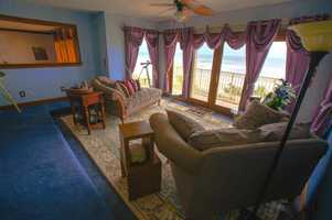 Enjoy ocean views from this suite's sitting area and balcony.