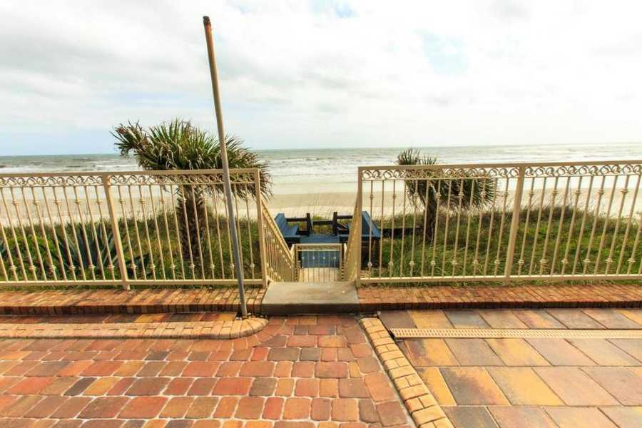 Last but not least, you're steps from the ocean. Which you can't beat! For more information on this property, visit Realtor.com.