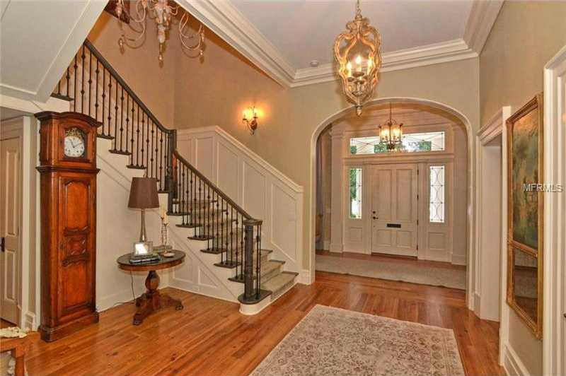 The foyer welcomes you with refinished hardwood floors.