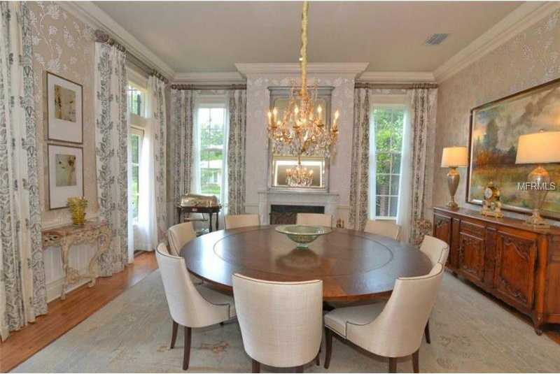 This elegant, well-lit dining room also boast a fireplace.